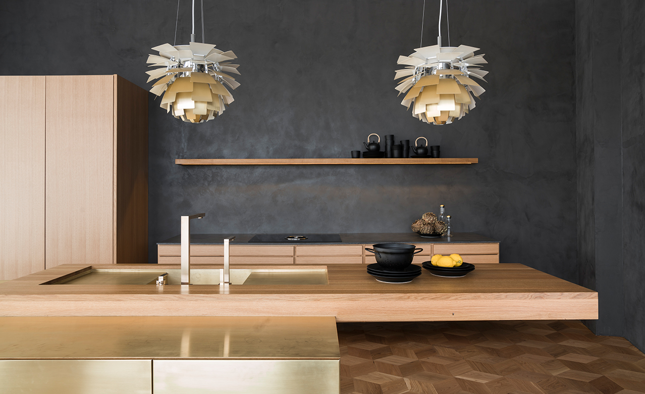A new classic. Award-winning kitchen design made from brass and oak.