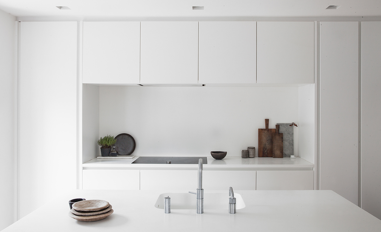 All white design kitchen in Kartoffelrækkerne in Copenhagen.