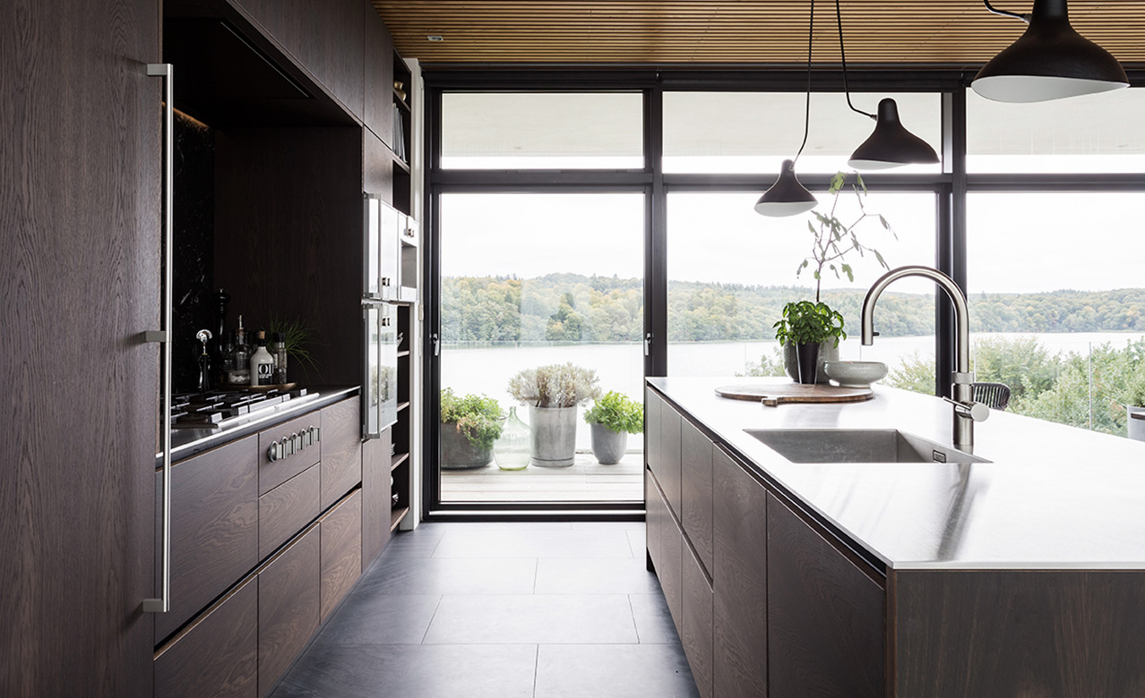 Design kitchen made from smoked oak overlooking the lake