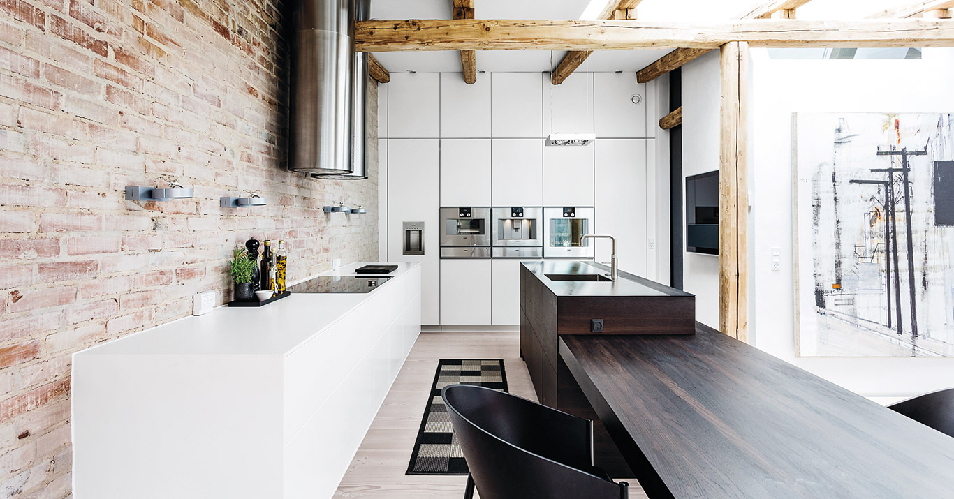 Luxury kitchen made from smoked oak, chalk white and stainless steel