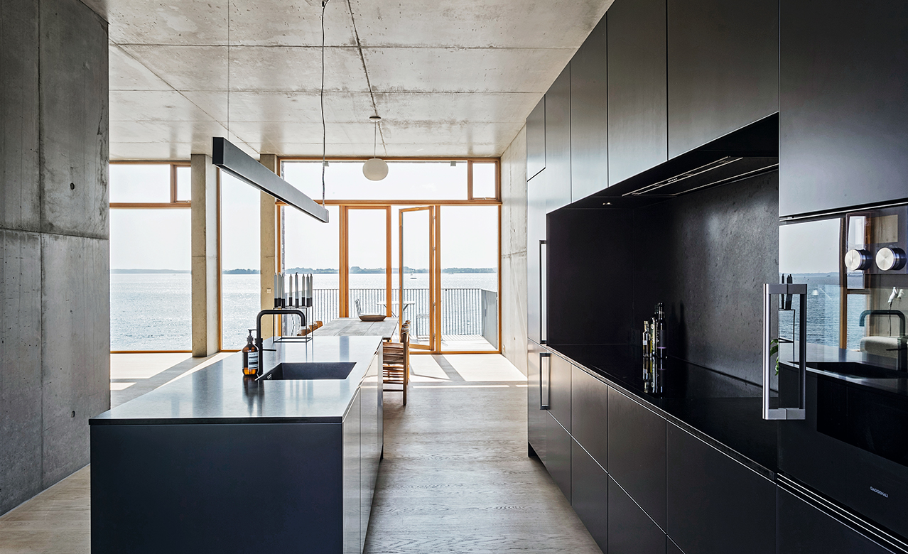 A minimalistic kitchen in the concrete home at the edge of Flensborg Fjord