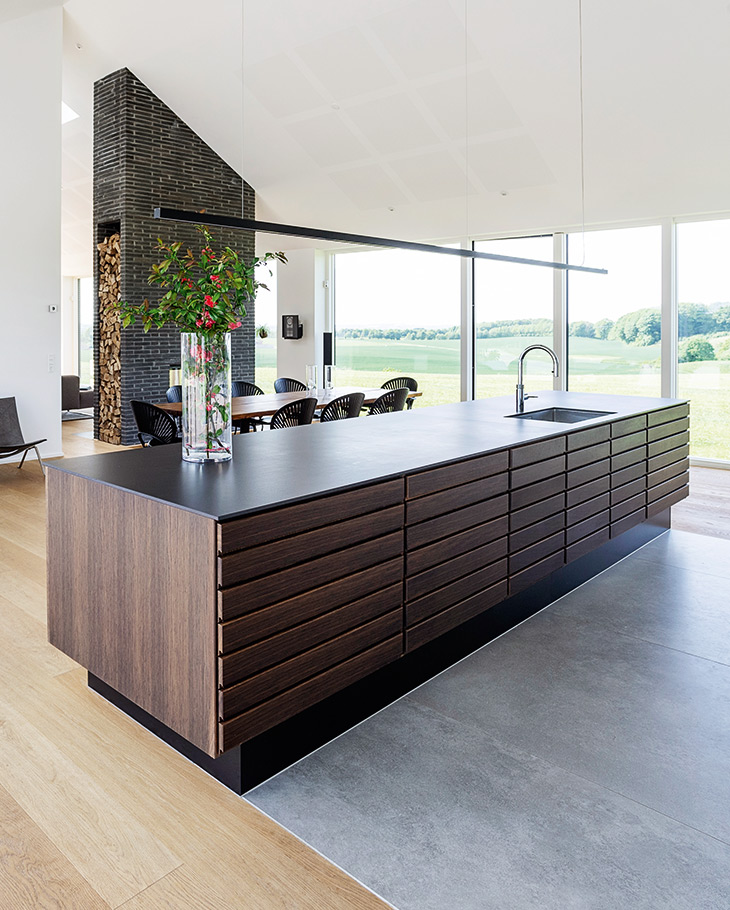 Form 1 kitchen island in smoked oak from Multiform is the center of the architect-designed farmhouse