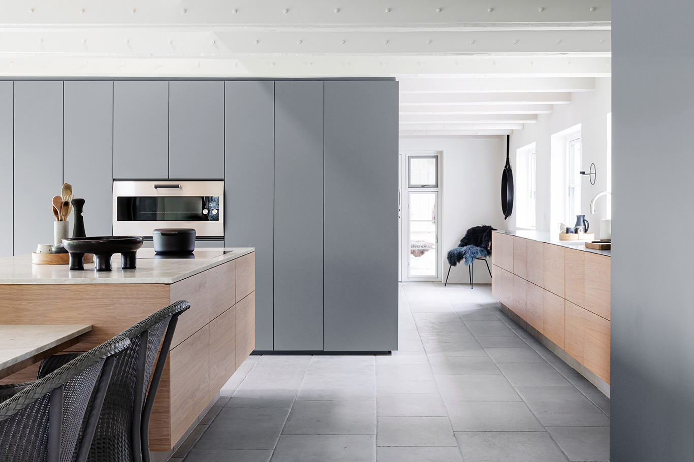 An architect-designed kitchen from Multiform made from slipmatched oak and grey Fenix