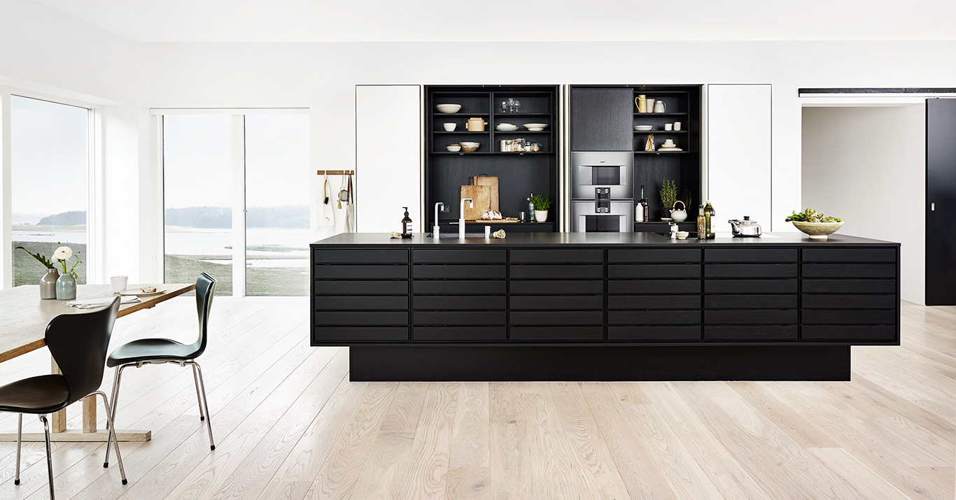The Form 1 kitchen island has been crafted from blackstained oak